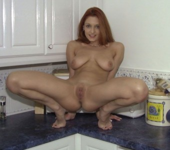 Naughty housewife spreading on the kitchen side